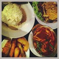 Photo taken at Sukhumvit Restaurant by Yasmin O. on 3/19/2013