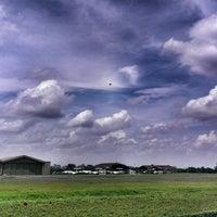 Photo taken at Bandar Udara Pondok Cabe (PCB) by Inda W. on 1/4/2014