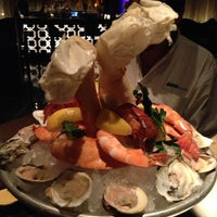 Photo taken at Jean Georges Steakhouse by Tom A. on 2/14/2013