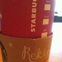 Photo taken at Starbucks by Andrea B. on 12/27/2012