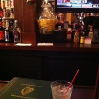 Photo taken at Mulligan's Pub by Britney P. on 5/31/2013