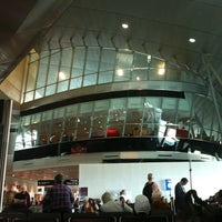 Photo taken at Concourse J by Chris A. on 11/29/2012