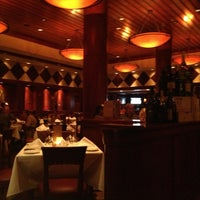 Photo taken at Fleming's Prime Steakhouse & Wine Bar by Greg R. on 4/8/2013