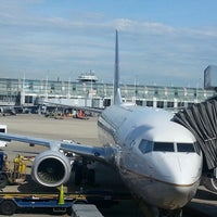 Photo taken at Gate B6 by Sam T. on 6/4/2013