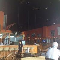 Photo taken at Röschti Rock Restaurant by Jose J. on 3/19/2013