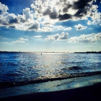 Photo taken at Cape Coral Beach at Yacht Club Community Park by Brian A. on 10/11/2014