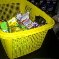 Photo taken at Alfamart by Sherly J. on 11/26/2012