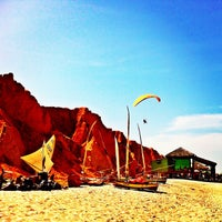 Photo taken at Praia de Canoa Quebrada by Melqui M. on 12/30/2012