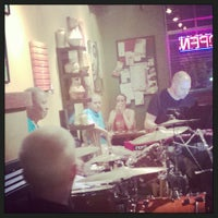 Photo taken at Artisan Coffee Bistro by kristin f. on 8/16/2014