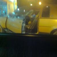 Photo taken at Chevron by Katia M. on 11/25/2012