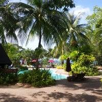 Photo taken at Mutiara Burau Bay Beach Resort by Ott V. on 12/26/2012