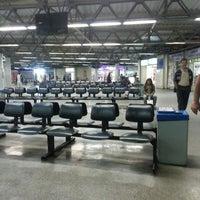 Photo taken at Terminal Rodoviário Miguel Mansur by Jeferson M. on 8/12/2013