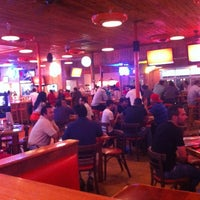 Photo taken at Hooters by Armando A. on 11/27/2012