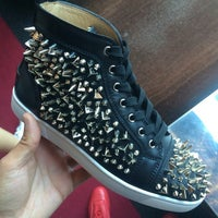 Photo taken at Christian Louboutin by Lucky P. on 6/13/2015