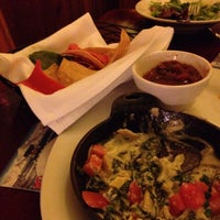 Photo taken at Tahoe Joe's Famous Steakhouse by Ella G. on 2/6/2015
