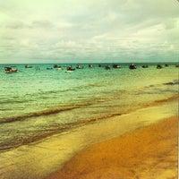 Photo taken at Praia de Tambaú by Carla Cristina S. on 12/24/2012