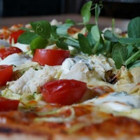 Photo taken at Giorgios Restaurant by Sam T. on 4/22/2014