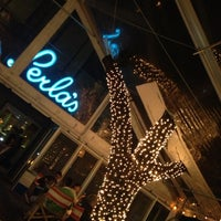 Photo taken at Perla's Seafood and Oyster Bar by Sean S. on 3/12/2013