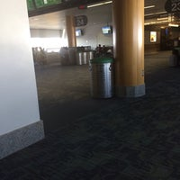 Photo taken at Gate 20 by Dante S. on 11/30/2013