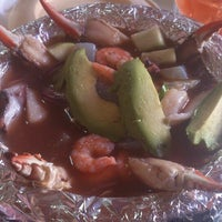 Photo taken at Wake up mariscos by America P. on 10/3/2013
