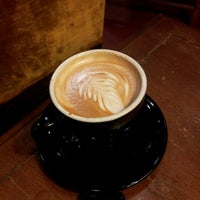 Photo taken at The Palace Coffee Company by Adam W. on 10/25/2012