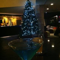 Photo taken at Poolside Bar at Hotel Menage by Cristal C. on 12/21/2012