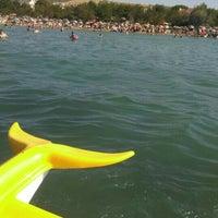 Photo taken at güneyli plajı by Özge Ö. on 8/7/2016