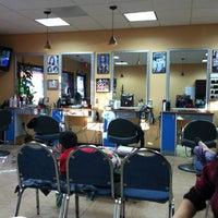 Photo taken at Magic Hair & Nails by Bill P. on 12/31/2012