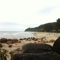 Photo taken at Pantai Teluk Cempedak (Beach) by Leo R. on 2/15/2013