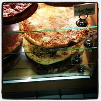 Photo taken at Regents Pizzeria by Sarah S. on 11/29/2012