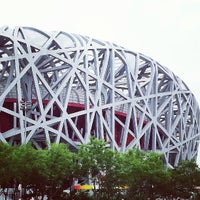 Photo taken at National Stadium (Bird's Nest) by Theo P. on 6/12/2013