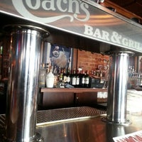 Photo taken at Coach's Bar & Grill by Joe K. on 10/1/2012