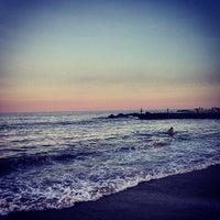 Photo taken at Long Branch Beach by Nikolai C. on 7/7/2013