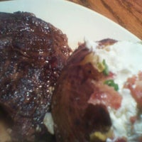 Photo taken at Outback Steakhouse by Shanell S. on 9/27/2012