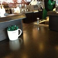 Photo taken at Starbucks by Megan S. on 3/25/2013
