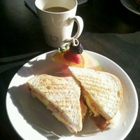 Photo taken at Lamplighter Roasting Co. by Sally L. on 12/23/2012