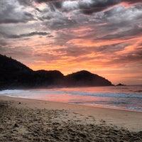 Photo taken at Praia Vermelha do Centro by Thiago P. on 7/21/2013