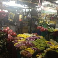 Photo taken at Dangwa Flower Market by Mariane D. on 4/1/2013