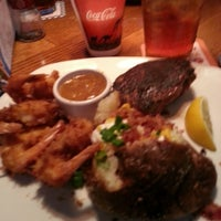 Photo taken at Outback Steakhouse by Christina P. on 3/31/2013