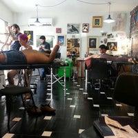 Photo taken at Cia da Tattoo by Alessandra F. on 11/30/2013