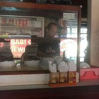 Photo taken at Babi Guling Pak Dobiel by Teguh W. on 9/18/2012