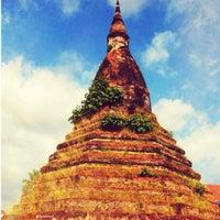 Photo taken at That Dam Stupa by Lanee on 11/13/2013