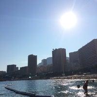 Photo taken at La Spiaggia Beach by Gianluca S. on 9/6/2014