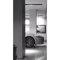 Photo taken at Aston Martin by dqktr on 7/14/2014