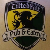 Photo taken at Tilted Kilt Pub & Eatery by Kristin D. on 7/13/2013