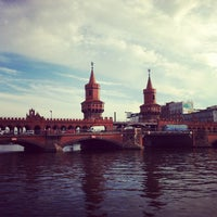 Photo taken at Oberbaumbrücke by Angel E. on 10/7/2012