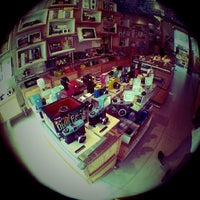 Photo taken at Lomography Gallery Store by Huang Z. on 7/5/2013