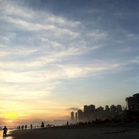 Photo taken at Praia da Barra da Tijuca by Leonardo K. on 3/16/2013