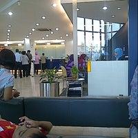 Photo taken at Bank Mandiri by Regina C. on 4/15/2013