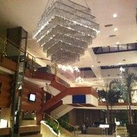 Photo taken at Tuğcan Hotel by Cagri Ç. on 12/5/2012